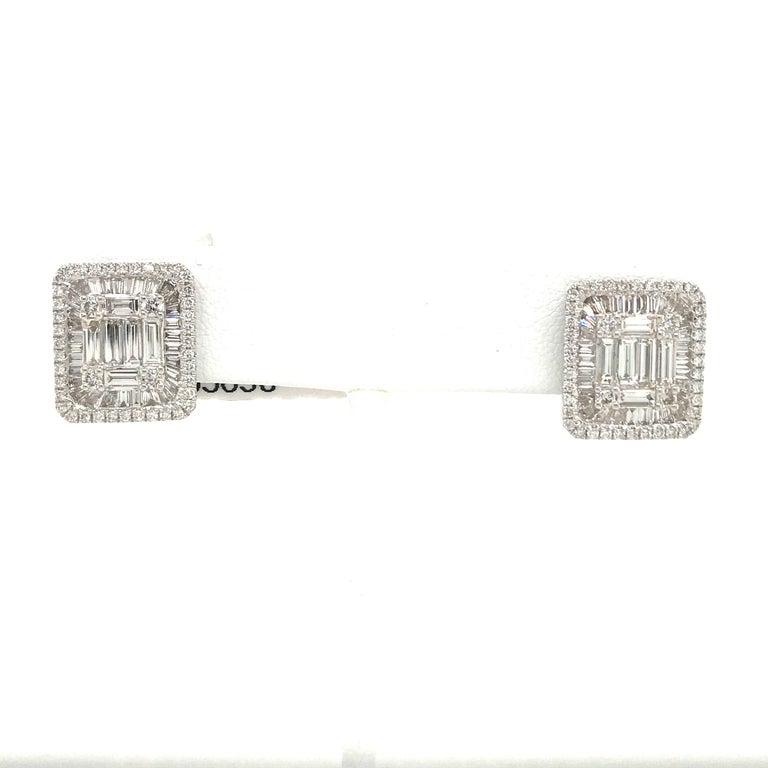 Bold diamond square stud earring featuring round brilliant and baguettes weighing 3.25 carats in 18k white gold. Color G Clarity VS-SI