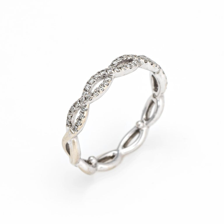 Finely detailed estate diamond ring, crafted in 14 karat white gold.   Round brilliant cut diamonds total an estimated 0.25 carats (estimated at H-I color and SI1-2 clarity)    The simple and sweet ring features a braided design. The ring is ideal