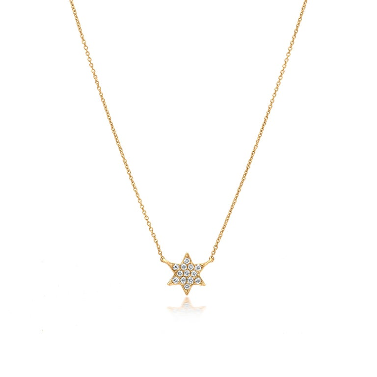 Grace your neckline with star pendant a representative of guidance, leading the direction you were meant to go. Subtle yet pretty this star pendant necklace is the new fashion statement. This gorgeous necklace is featured with 13 round cut diamonds,