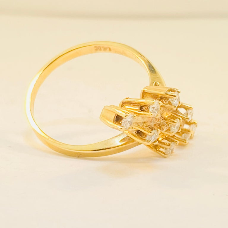 This ring has elegance and grace to it! This 14 Karat Yellow Gold Diamond ring is a gorgeous piece that will stand out anywhere you go!  14 Karat Yellow Gold Diamonds (9) - 0.30 Total Carat Weight  Diamond Clarity-VS1 (Excellent) Diamond Color-G