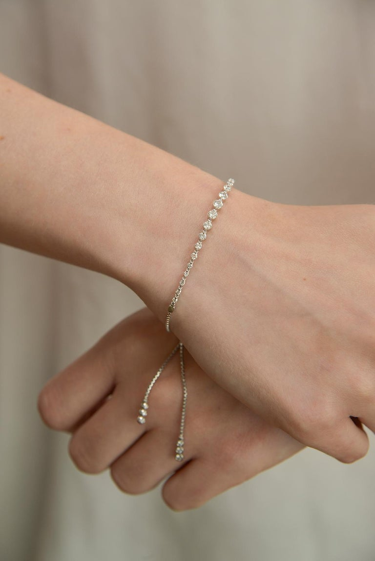 A new twist on the diamond tennis bracelet. The Diamond string bracelet featuring 1.25 brilliant cut diamonds in 18k white gold with geometric clasp. Adjustable sizing