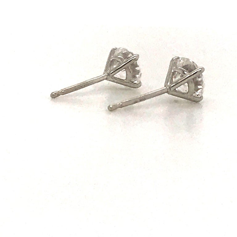 Diamond Stud Earrings 1.40 Carat E-F SI2 14 Karat White Gold For Sale 1