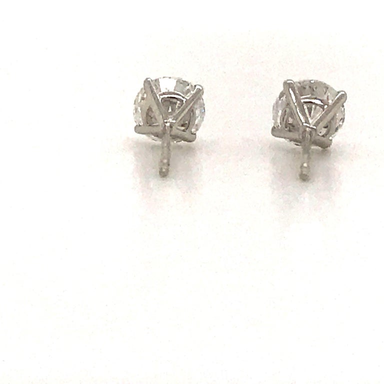 Diamond Stud Earrings 1.40 Carat E-F SI2 14 Karat White Gold For Sale 2