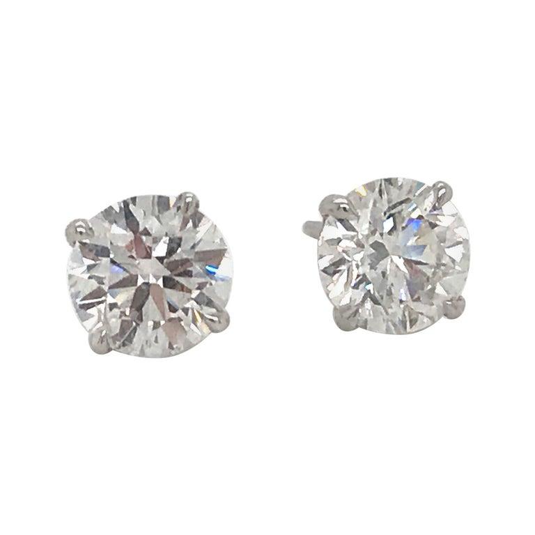 Diamond Stud Earrings 1.40 G-H SI1 14 Karat White Gold For Sale