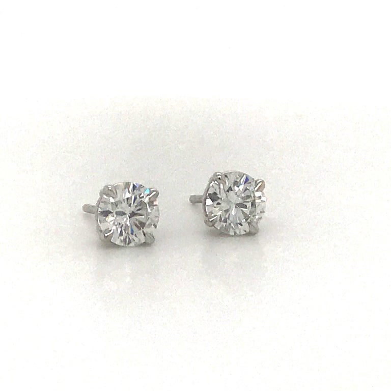 Diamond stud earrings weighing 1.43 carats in a 14k white gold 4 prong classic setting. Color F-G Clartiy SI3-I1