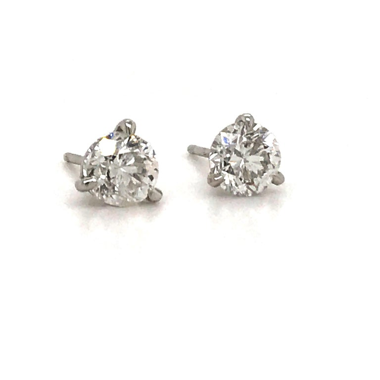 Diamond stud earrings weighing 1.60 carats in a 14k white gold 3 prong martini setting. Color E-F Clarity SI2-SI3