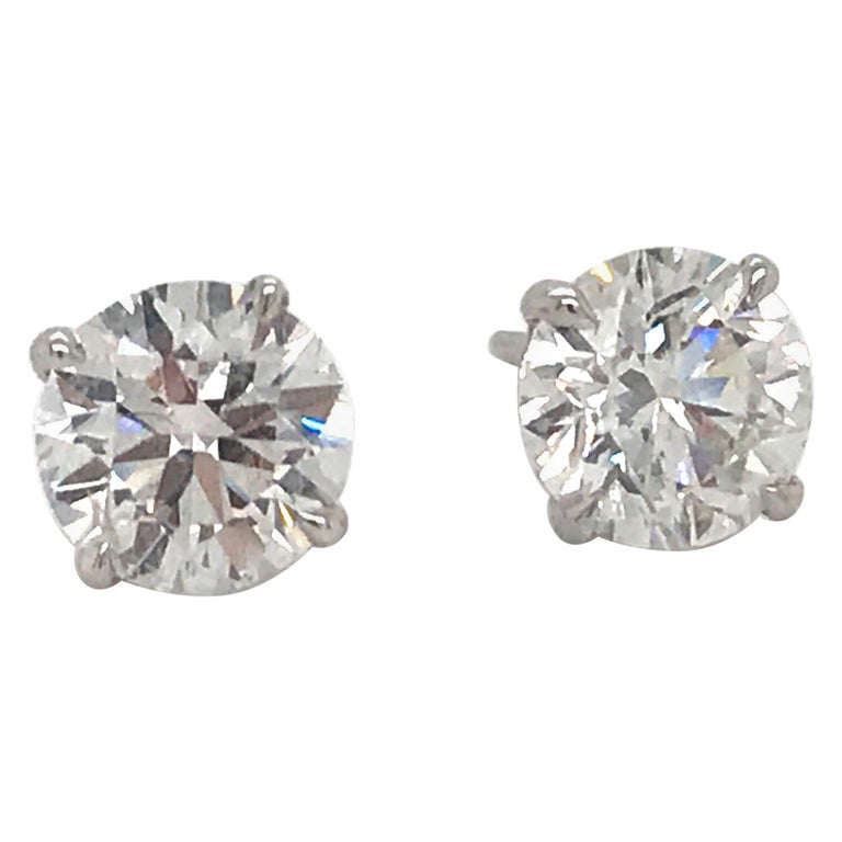 Diamond Stud Earrings 1.97 Carat H I1 14 Karat White Gold For Sale