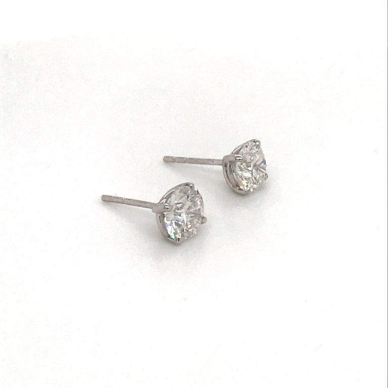 Contemporary Diamond Stud Earrings 1.97 Carat H I1 14 Karat White Gold For Sale