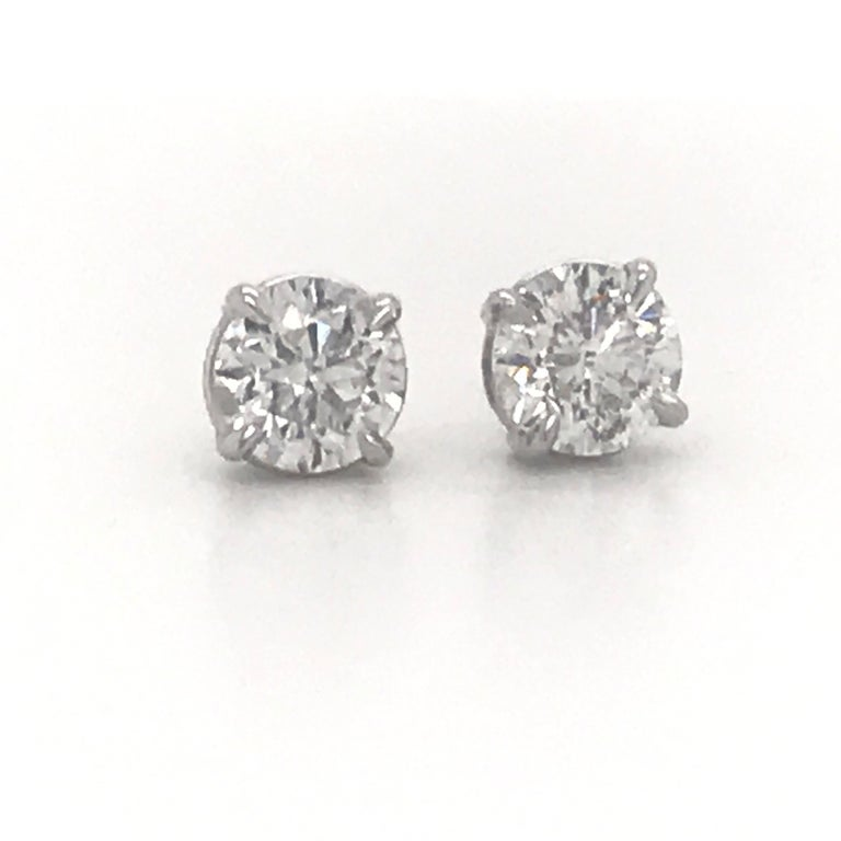 Diamond Stud Earrings weighing 2.02 Carats in a  14K white gold 4 prong classic setting. Color G-H  Clarity SI3