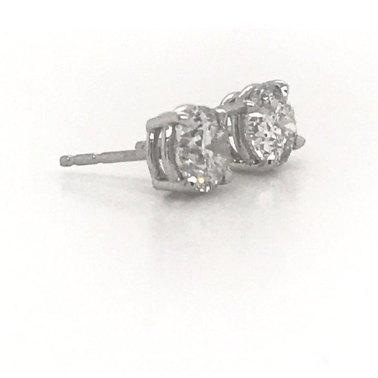 Round Cut Diamond Stud Earrings 2.02 Carat G-H SI3 14 Karat White Gold For Sale