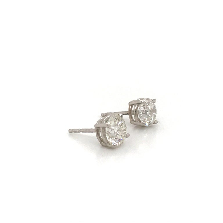 14K White gold diamond stud earrings weighing 2.02 carats in a 4 prong classic setting.  Color G Clarity I1-I2