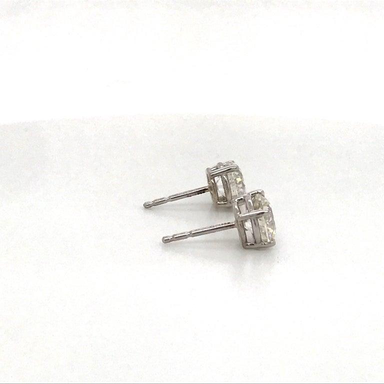 Round Cut Diamond Stud Earrings 2.02 Carat G I1-I2 14 Karat White Gold For Sale