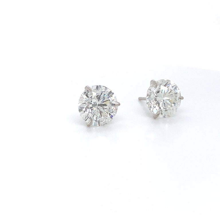18K White gold diamond stud earrings weighing 2.84 carats in a 3 prong champagne setting. Color H-I Clarity SI2-I1  Very Brilliant Cut Stones.  Eye Clean