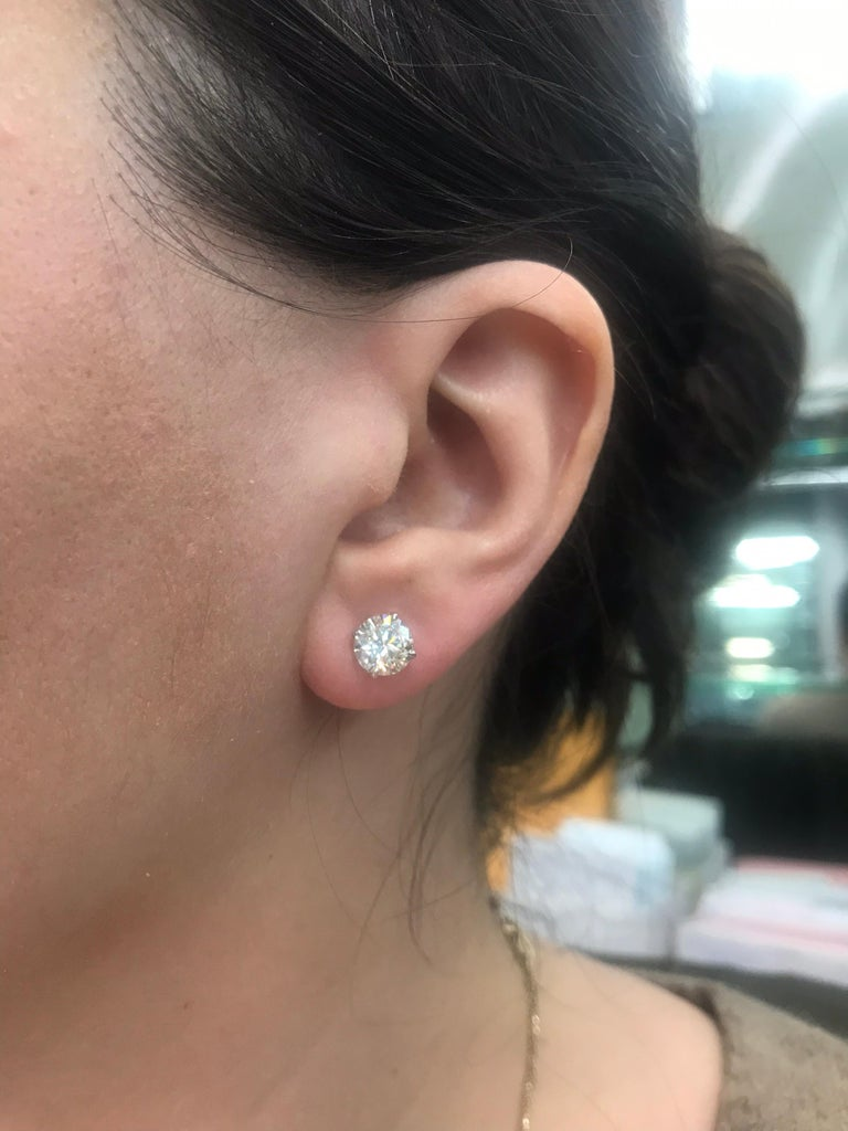 Diamond stud earrings weighing 3.00 carats in a 4 prong 18k white gold champagne setting. Color I-J Clarity VS2