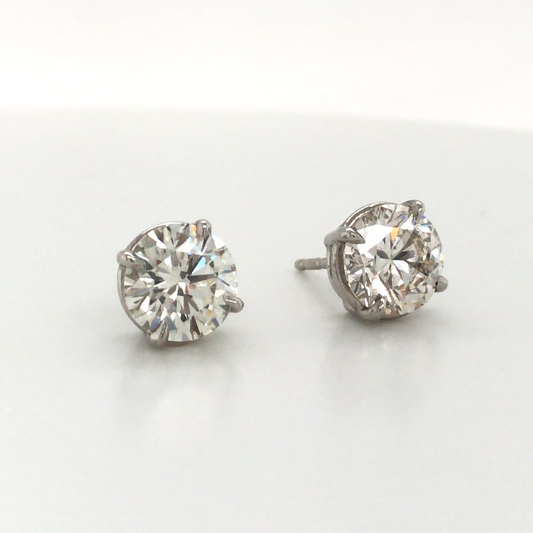 14K White gold diamond stud earrings weighing exactly 3.00 carats in a 4 prong classic setting. Color J Clarity VS2-SI1  Brilliant stones, nice shine!  Please email for more selection.