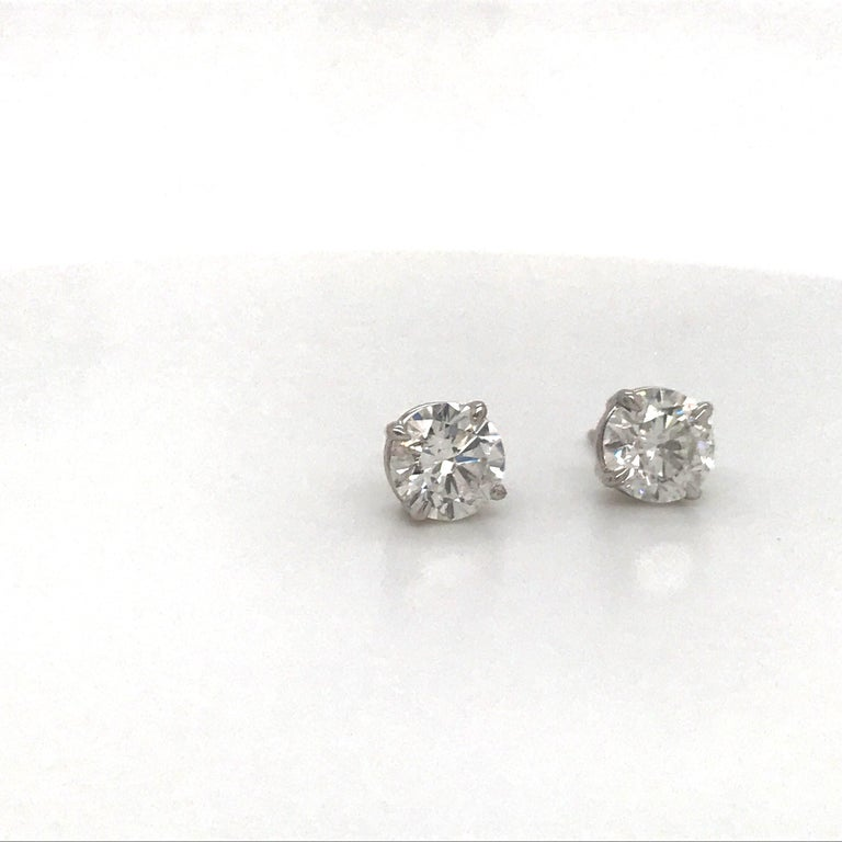 14K White gold diamond stud earrings weighing 3.01 carats in a 4 prong classic setting. Color H Clarity I1