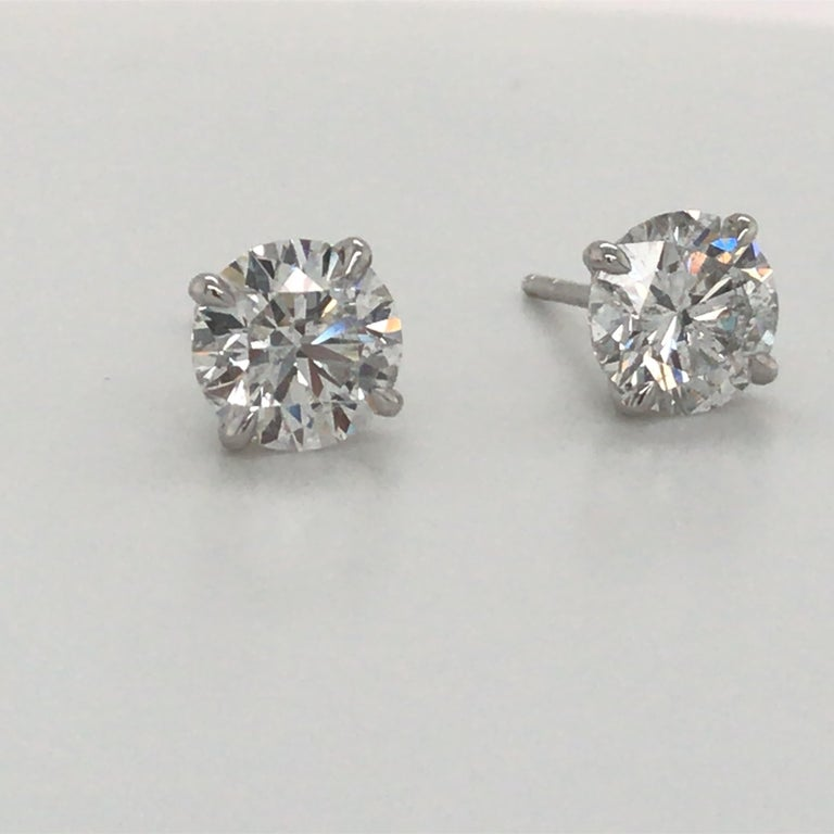 18K White gold diamond stud earrings weighing 3.06 carats in a 4 prong champagne setting.  Color G-H Clarity SI3-1  Brilliant Diamonds, Eye Clean  Please email for additional studs list.