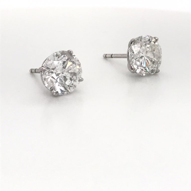 18K White gold diamond stud earrings weighing 3.17 carats in a 4 prong champagne setting.  Color H Clarity I1