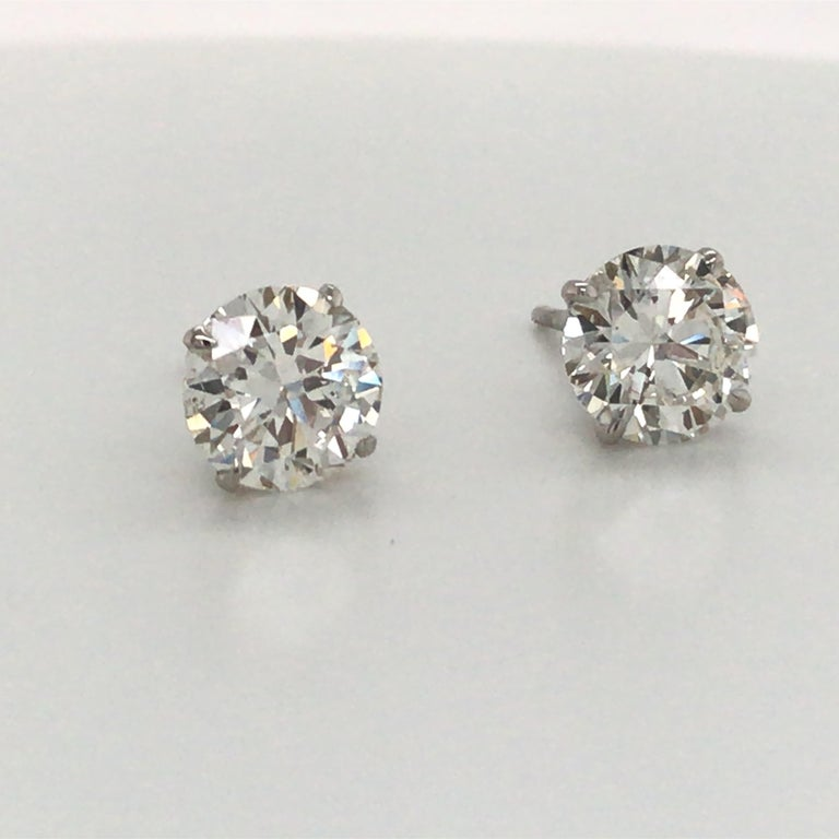 18K White Gold diamond stud earrings weighing 3.41 carats in a 4 prong champagne setting. Color H-I Clarity SI2-I1  Please email for additional diamond stud list.