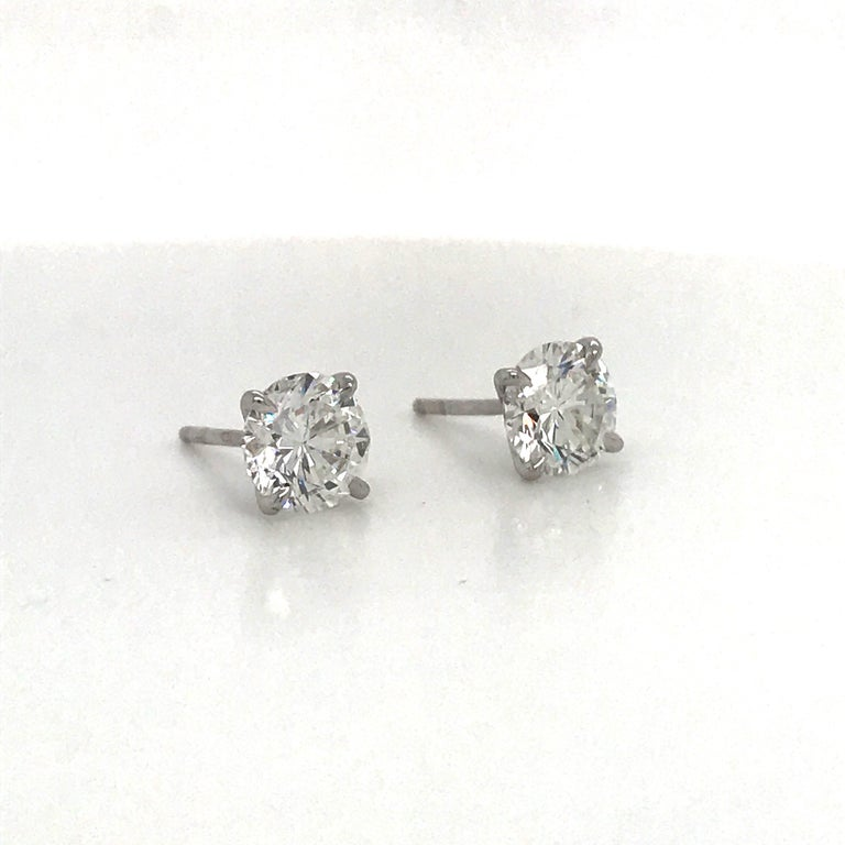 Diamond stud earrings weighing 4.03 carats in a four prong martini setting, 18K white gold. Color I Clarity SI2