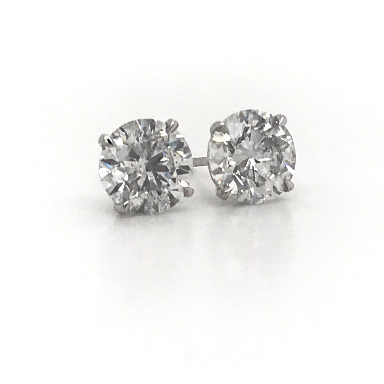 Diamond stud earrings weighing 4.07 Carats in 18K white gold 4 prong champagne studs. Color I  Clarity I1