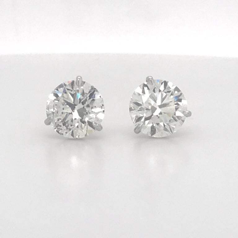 Diamond stud earrings weighing 4.81 Carats in 18K white gold 3 prong champagne setting.  Color I-J Clarity I1