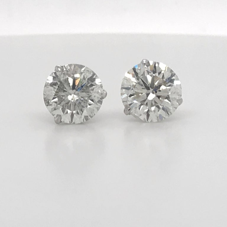 Diamond stud earrings weighing 4.87 Carats in a 14K white gold 3 prong martini setting.  Color I-J  Clarity I1