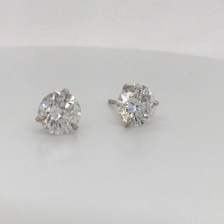 18K White gold diamond stud earrings weighing 5.04 carats in a 3 prong champagne setting. Color F Clarity I1  Please email for additional diamond list.