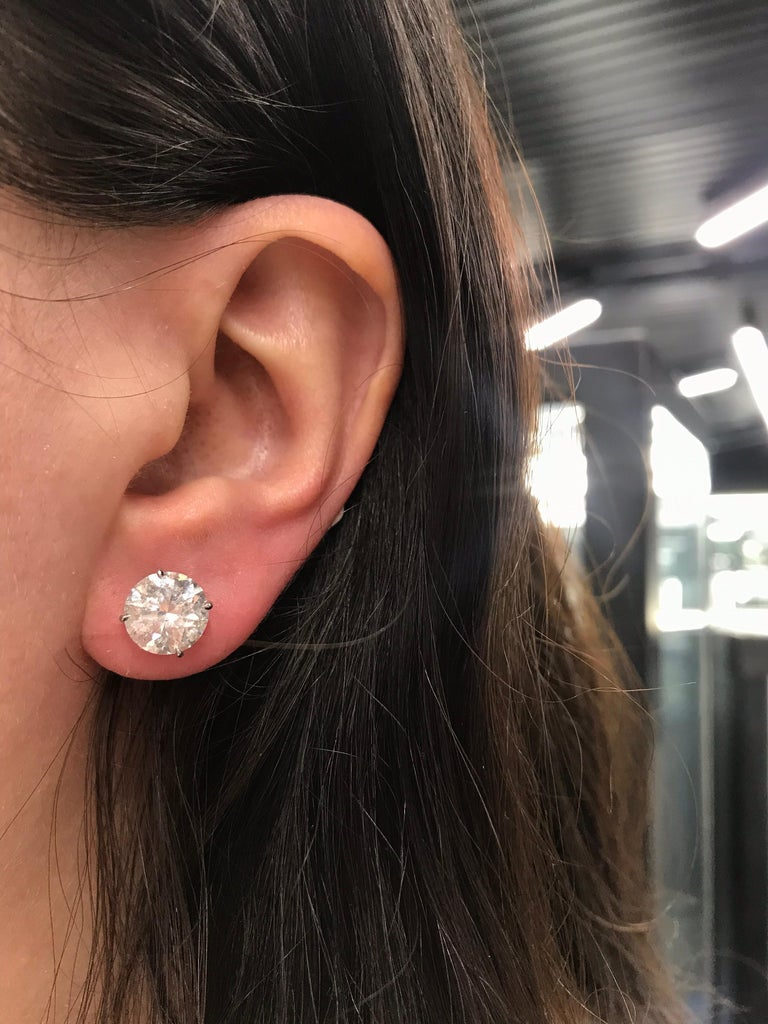 18K White gold diamond stud earrings weighing 6.09 carats in a 4 prong champagne setting. Color G-H Clarity I1