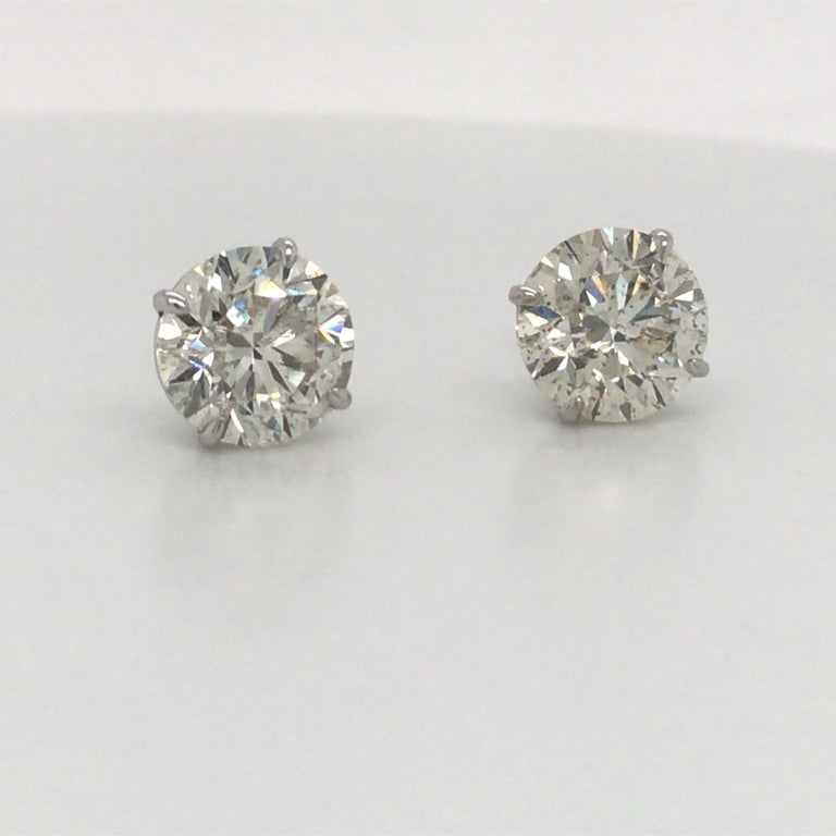 18K White gold diamnd stud earrings weighing 6.23 carats in a 4 prong champagne setting. Color I-J Clarity SI3-I1   Please email for our additional 6 carat studs.