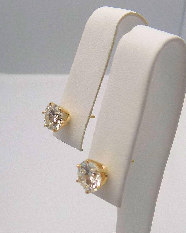 Pair 14 Karat Yellow Gold and Diamond Stud Earrings with Screw Backs. 2 Round Brilliant Diamonds 2.75 Carat Total Weight, Laser Treated I-1, I-J. 1.1 DWT or 1.71 Grams.