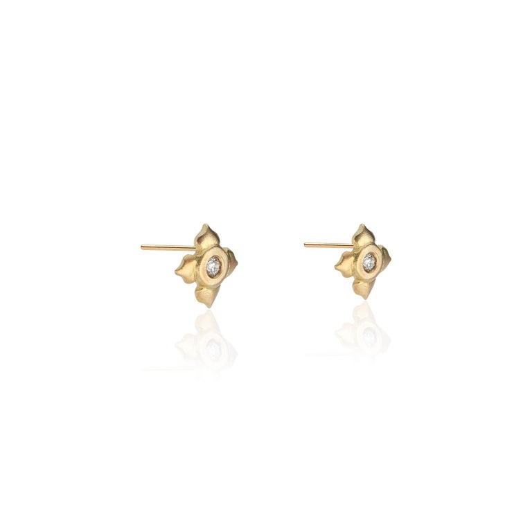 18k Yellow gold lotus flower matte finished studs set with two brilliant cut diamonds (.0433 approx tcw for each stone), hand crafted by Susan Mancuso of Forge & Foundry Jewels.