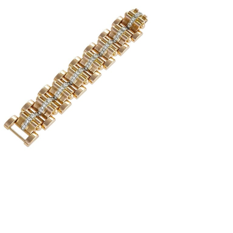 The diamond line that courses through this Retro rose gold tank bracelet lends scintillating delicacy to the powerful form. Composed of a series of rose gold panel and bar links, the softly undulating surface is contoured by round-cut diamonds