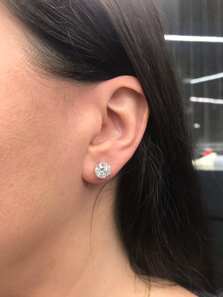 GIA Certified diamond stud earrings weighing 4.31 carats total weight, in 18k white gold four prong champagne setting.  Color: I-J Clarity: I1