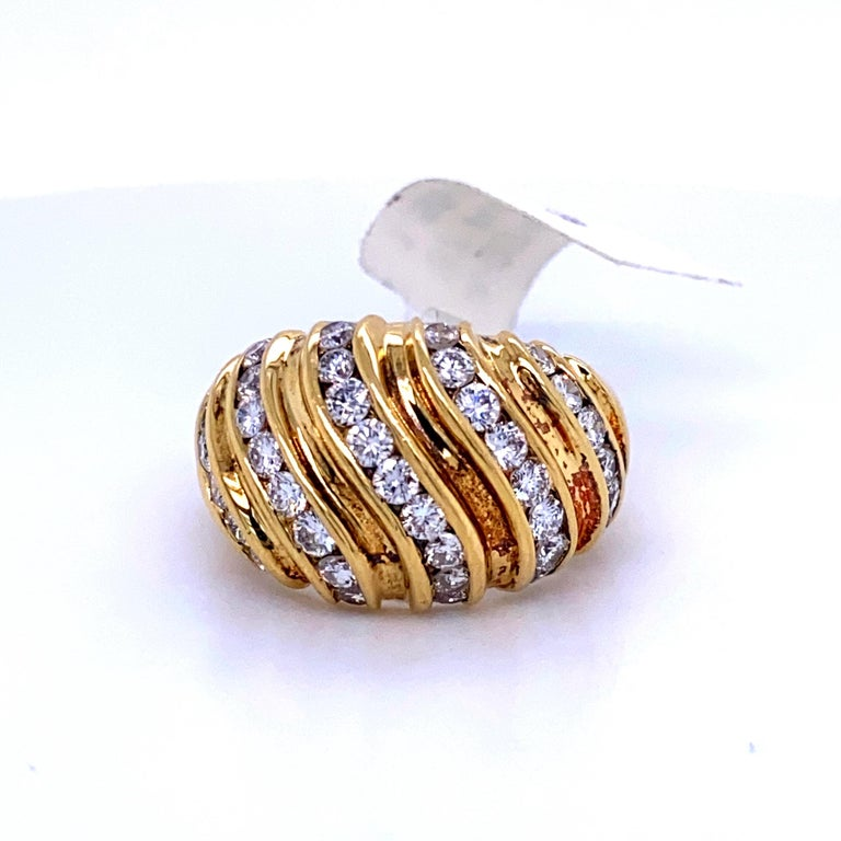 18K Yellow gold dome ring featuring 37 round brilliants weighing 1.55 carats.  Average Stone: 0.04 cts Color G Clarity SI  Size 6.5,  Can be sized free of charge