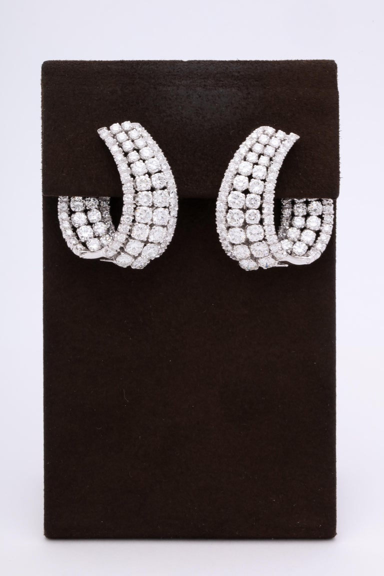 A STUNNING pair of diamond earrings!  21.02 carats of white round brilliant cut diamonds set in white gold.   The earrings measure approximately 1.4 inches long and 1.20 inches wide.   Inspired by the worlds most famous jewelry designers, similar
