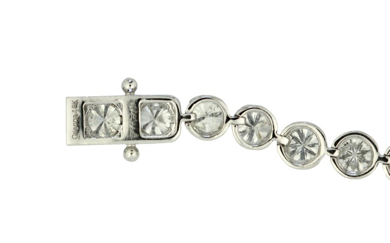 DIAMOND BRACELET  The tennis bracelet composed of brilliant-cut diamonds together weighing approximately 11.50 carats, mounted in 18 karat white gold, length approximately 7 inches