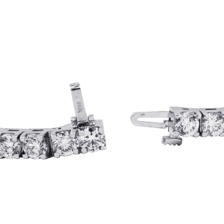 Material: 14k White Gold Diamond Details: Approximately 11.93ctw of round brilliant diamonds. Diamonds are G/H in color and SI in clarity Wrist size: Will fit up to a 7″ wrist Bracelet Measurements: 7″ x 0.16″ x 0.16″ Total Weight: 22.4g