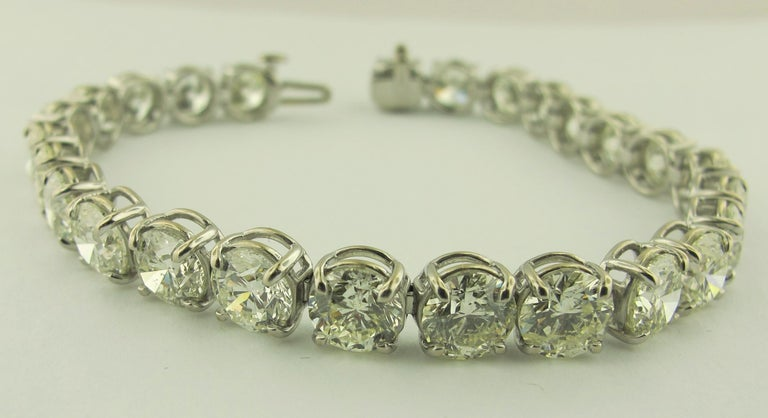 Straight-line Diamond bracelet with 26 round brilliant cut diamonds with a total weight of 19.24 carats.  Color J-K, Clarity VS.  Set in Platinum.