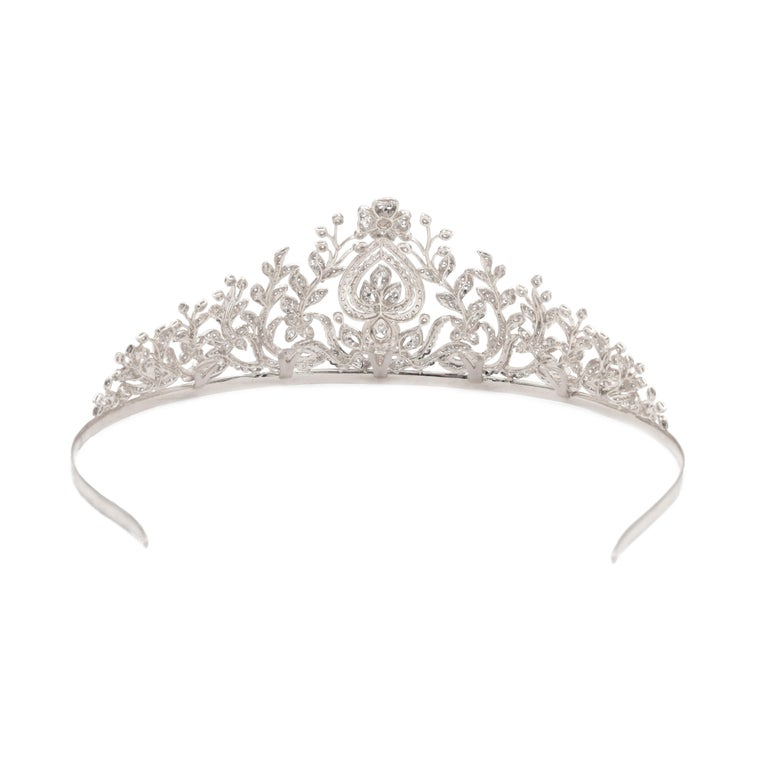 Diamond tiara,   The floral design of the tiara is set with multiple round brilliant cut diamonds, six marquise cut diamonds and one pear shape diamond weighing total of approximately 20carats.  measures 5.5 inches in width and it's 2.25 inches