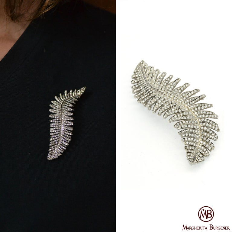 Handcrafted in Margherita Burgener workshop, based in Valenza, Italy, the brooch is designed and handmade in titanium and fully pavé set in diamonds.  Being extremely light, the brooch it is very suitable on any fabric.  The natural grey color of