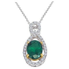 Diamond Town 1.26 Carat Oval Cut Emerald and 0.22 Carat Diamond Pendant