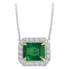 Diamond Town 2.33 Carat Emerald Cut Emerald Pendant with 0.32 Carat Diamond Halo