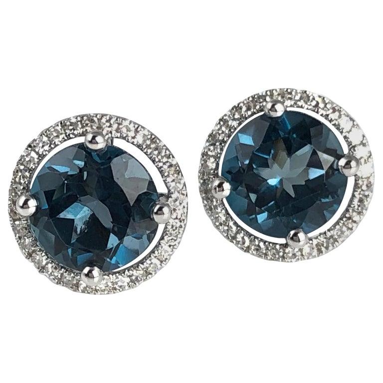 Diamond Town 3.58 Carat London Blue Topaz Halo Stud Earrings in 14 Karat Gold For Sale