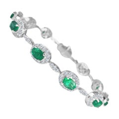Diamond Town 4.63 Carat Oval Cut Emerald and Diamond Bracelet in 18 Karat Gold