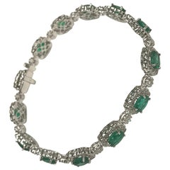 Diamond Town 5.86 Carat Oval Cut Emerald and 3.71 Carat Diamond Bracelet in 18k