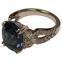 Diamond Town 6.37 Carat Oval Cut London Blue Topaz and 0.78 Carat Diamond Ring