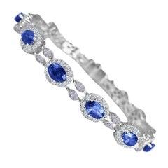 Diamond Town 6.79 Carat Oval Vivid Blue Sapphire and 4.69 Carat Diamond Bracelet