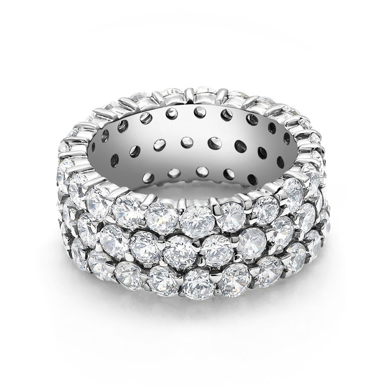 18 Karats white gold triple row diamond prong set eternity ring Diamond weighing 5.56 carat  Each diamond measures 8 millimeters, 0.06 carat each stone Made to order in all finger sizes Special order rings are not refundable  Two weeks delivery  New