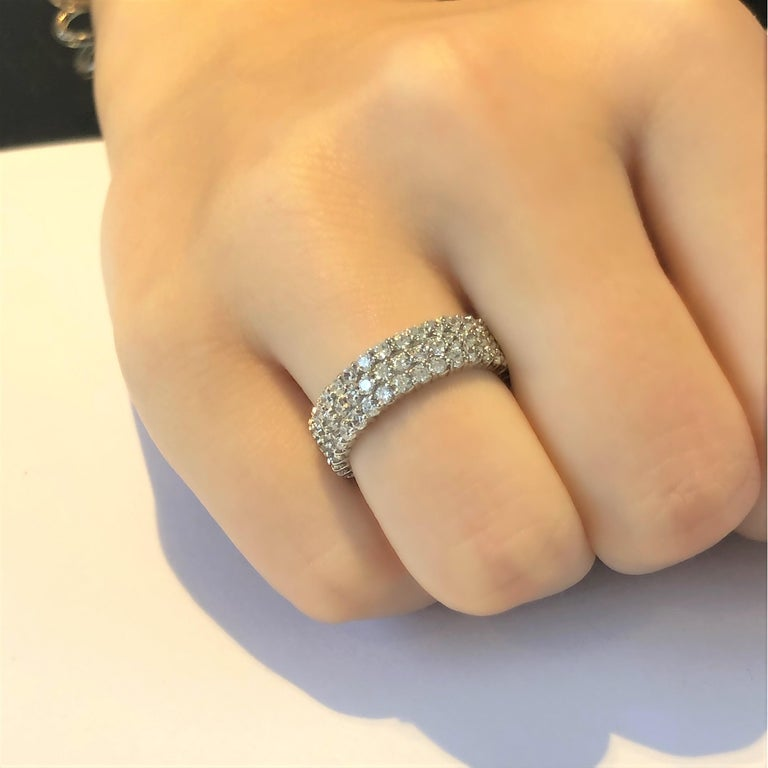 Contemporary Triple Row Diamond Prong Set Eternity 18 Karats Gold Ring Weighing 5.52 Carat For Sale